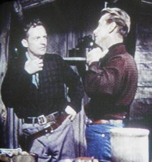 Arthur Kennedy with Alan Ladd (in Red Mountain, 1951